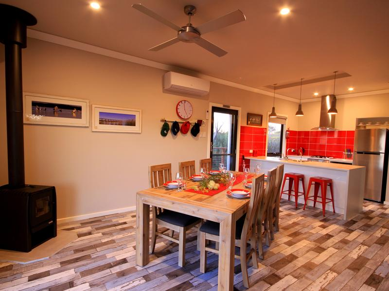 Kitchen and dining area with combustion heater